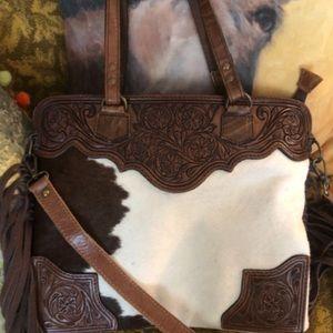 Cowhide fringe purse
